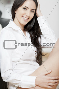 Young woman sat on the floor in sitting room