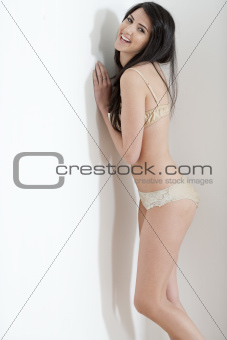 Young woman in underwear at home