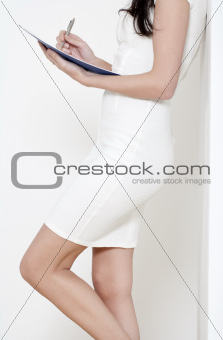 Woman with white dress holding documents