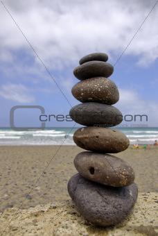 Balancing beach pebbles