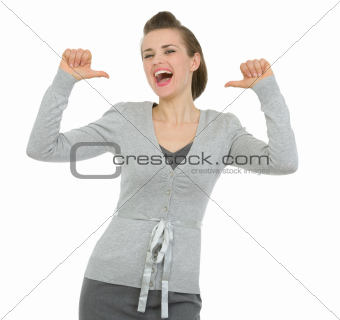 Happy business woman pointing on herself