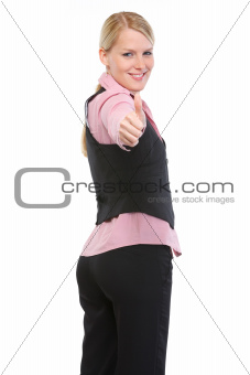 Smiling woman showing thumbs up