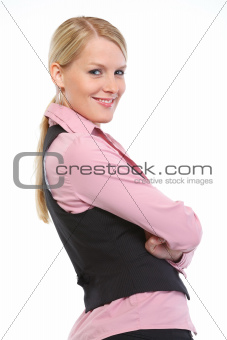 Portrait of smiling woman with crossed arms