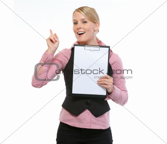 Woman employee showing blank clipboard