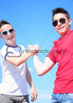 Teenager shaking hands
