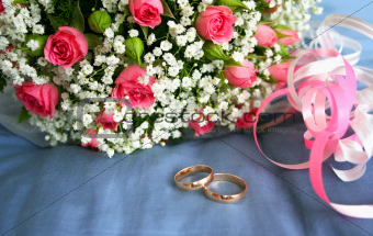 wedding background with beautiful bouquet and gold rings