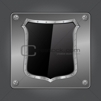 Black shield on metal board