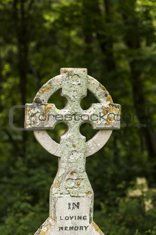 In loving memory with cross in Graveyard
