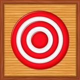 Red target on wooden background