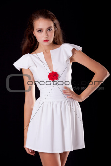 Unapproachable young woman in cocktail dress
