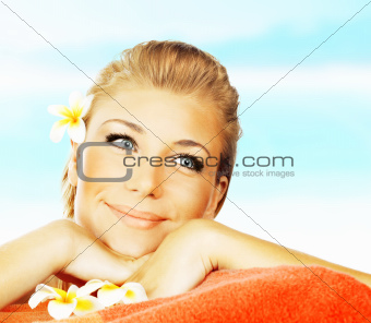 Woman on spa massage bed on the beach