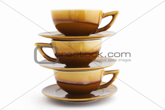 three cups on white background