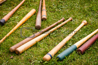 Vintage Baseball Bats Scattered on the Ground