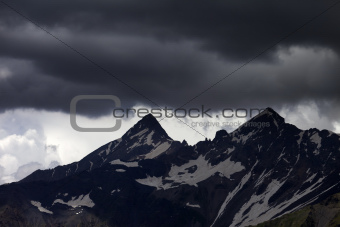 Storm clouds in mountains