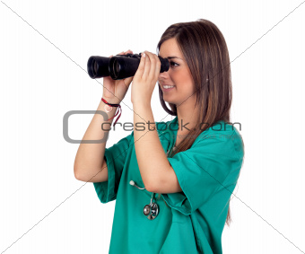 Atractive medical girl looking through binoculars