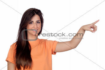 Attractive girl with long hair indicating something by hand