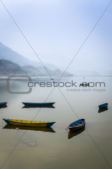 Tour boats on Pokhara Fewa lake in Nepal