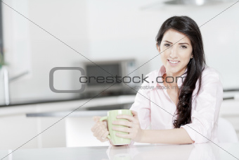 Young woman sat at table with drink