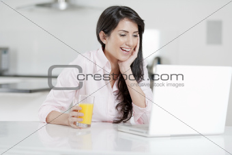 Girl chatting with friends on laptop