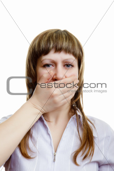 young girl covers her mouth with his hands