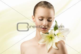 beauty portrait with flowers, she looks lilies