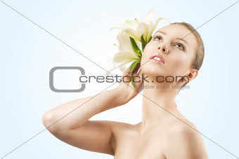 beauty portrait with flowers, she looks up