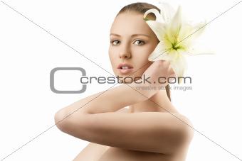 beauty portrait with flowers near the ear