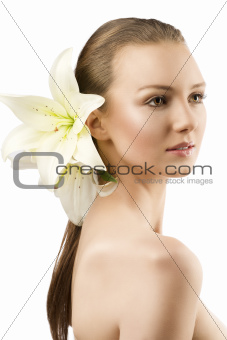 beauty portrait with flowers the girl is turned of three quarter