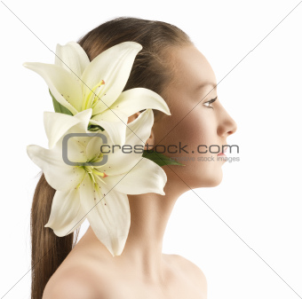 beauty portrait with flowers, the girl is turned in profile