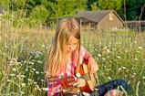 Playing guitar in field