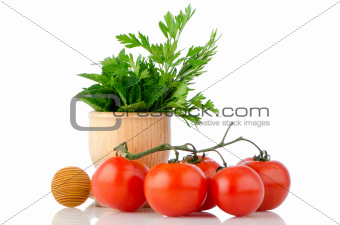 Tomatoes and green herb leafs