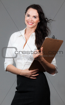 Successful woman with clipboard