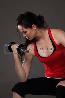 Beautiful woman lifting weights