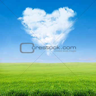 green field blue sky with cloudy heart