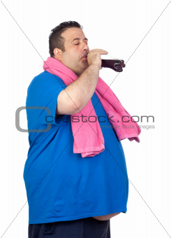 Fat man in the gym drinking cola