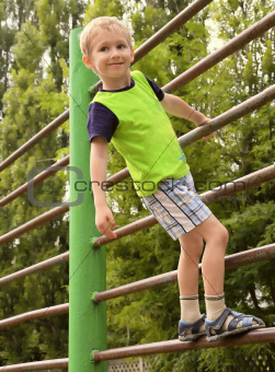 Child Boy playing on stairs playground