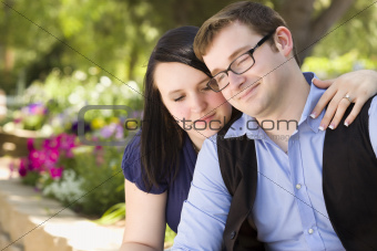 Attractive Young Engaged Couple Relaxing in the Park Together.