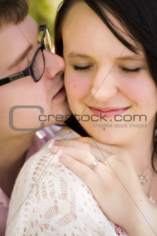 Attractive Young Engaged Couple Sharing an Intimate Moment in the Park.