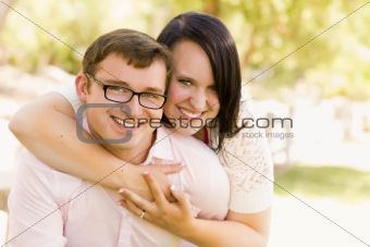 Attractive Young Couple Having Fun Outside in the Park