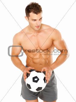 Handsome man holding soccer ball on white