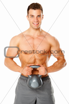 Fit muscular man exercising with dumbbell on white