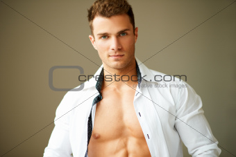 Portrait of muscular man posing in white shirt