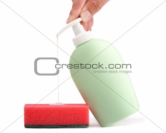Bottle of liquid soap and cleaning sponge