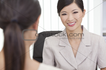 Asian Chinese Woman or Businesswoman in Office Meeting