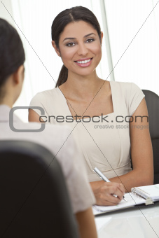 Hispanic Latina Woman or Businesswoman in Office Meeting