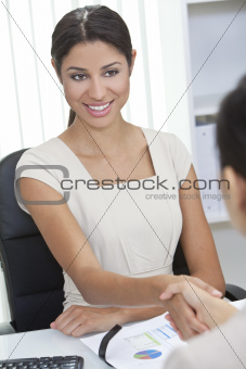 Hispanic Woman Businesswoman Shaking Hands in Office