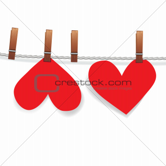Red paper heart attached to a clothesline with pin