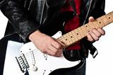 Guitarist playing on electric guitar isolated on white backgroun