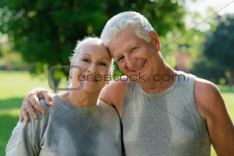Portrait of elderly couple after fitness in park