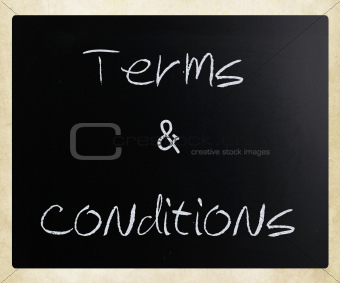 """Terms & Conditions"" handwritten with white chalk on a blackboar"